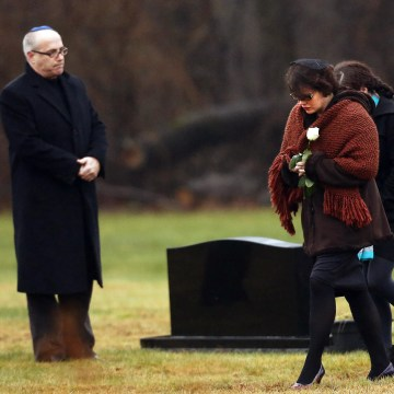 Image: Veronique Pozner, mother of Sandy Hook Elementary School shooting victim Noah Pozner, arrives at his gravesite for his burial at the B'nai Israel Cemetery in Monroe, Connecticut