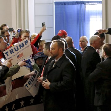 Image: U.S. Republican presidential candidate Trump points at a supporter as he leaves the building after speaking at a campaign event at the Veterans Memorial Building in Cedar Rapids