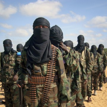 Image: Armed members of the militant group al-Shabab attend a rally on the outskirts of Mogadishu