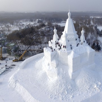 Image: Workers polish a snow sculpture ahead of the annual Harbin International Ice and Snow Festival, in Harbin