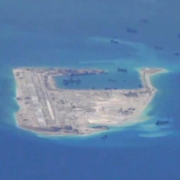 Image: Chinese dredging vessels are purportedly seen in the disputed Spratly Islands in the South China Sea in this U.S. Navy image taken on May 21.