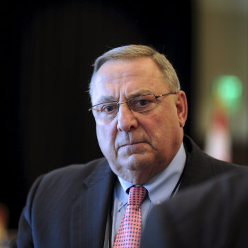 Image: Maine Governor LePage listens while speaking with an attendee to the 23rd Annual Energy Trade & Technology Conference in Boston