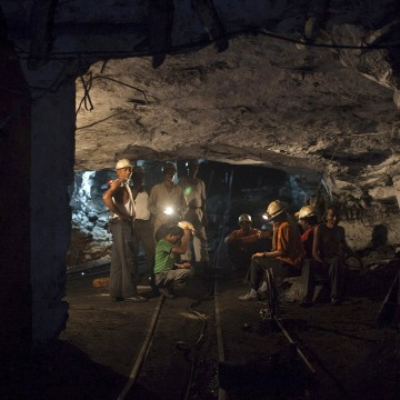Image: File photo of miners resting inside an underground Barora coal mine at Dhanbad district