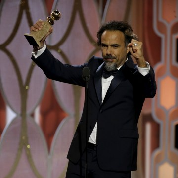 "Image: Inarritu reacts after winning the Best Director - Motion Picture for ""The Revenant"", at the 73rd Golden Globe Awards in Beverly Hills"