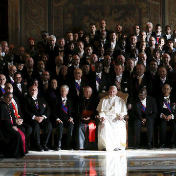 Image: Pope Francis poses with ambassadors during an audience with the diplomatic corps at the Vatican