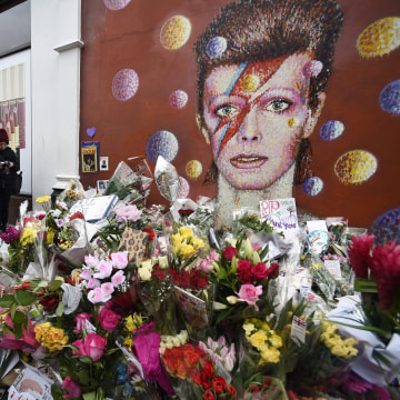 Image: Well-wishers flock to Bowie mural in Brixton following the singer's death