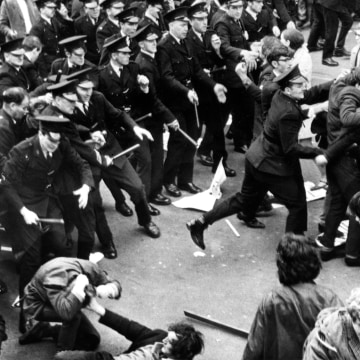 Image: A crowd of civil rights demonstrators scatter as the police begin a baton charge in Londonderry, Northern Ireland, on Oct. 5, 1968.