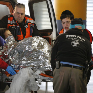 Image: An injured Israeli woman is evacuated