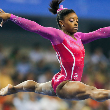 Image: Simone Biles operforms on the Balance Beam