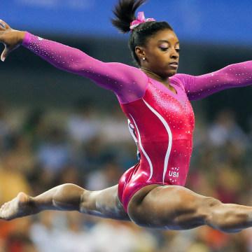 Image: Simone Biles operforms on the Balance Beam