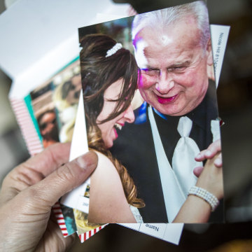 Image: Flushing resident Terri Nelson looks through old pictures of her husband Dwayne Nelson