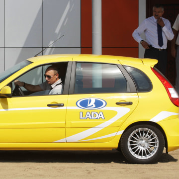 Image: Russia's Prime Minister Vladimir Putin drives a Russian-made Lada Kalina car