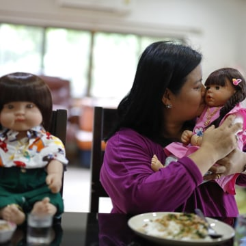 "Image: Ratchada Mahanavanont with ""child angel"" doll"