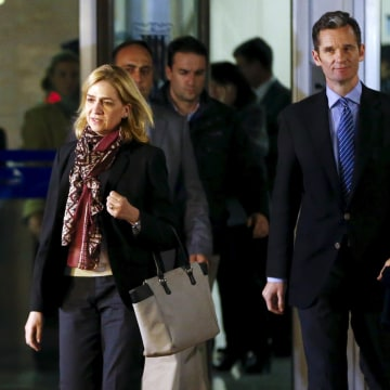 Image: Spain's Princess Cristina, the first member of the royal family ever to stand in the dock, and husband Inaki Urdangarin leave court in Palma de Mallorca