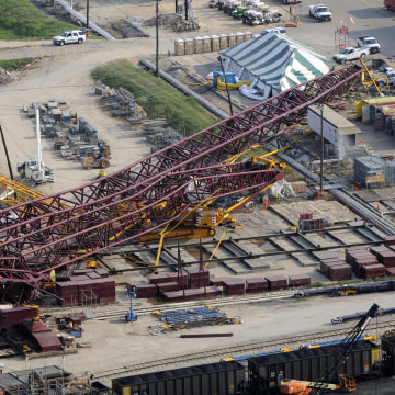 Image: A collapsed crane is visible within the LyondellBasell Houston Refinery on July 18, 2008 in Houston.