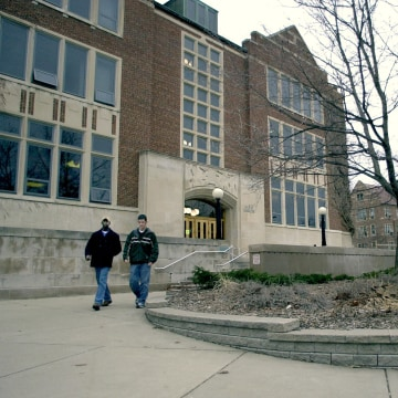 Image: Students leave the student union building on campus at Michigan State University