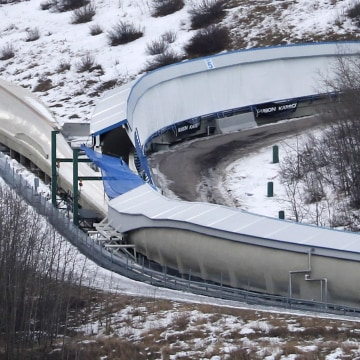 Image: A tarp covers the intersection of the bobsled and luge tracks at Canada Olympic Park in Calgary, Canada, on Saturday, Feb. 6, 2016.