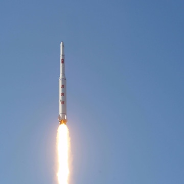 Image: A North Korean long-range rocket is launched into the air at the Sohae rocket launch site in this undated photo released by North Korea's Korean Central News Agency (KCNA) in Pyongyang