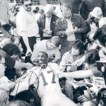 11-1988; Special to the Denver post -- Redskins quarterback Doug Williams entertains a horde of pres