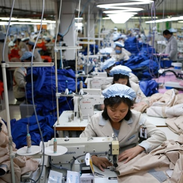 Image: North Korean employees working at a factory of a South Korean-owned company