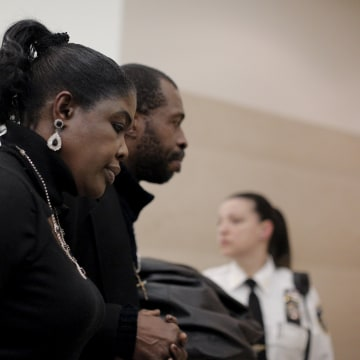 Image: Sylvia Palmer, mother of Akai Gurley, is led from the court room at the Brooklyn Supreme court in the Brooklyn borough of New York