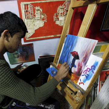 Image: An orphan boy draws at the Iraqi Safe House for Creativity in Baghdad