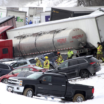 Image: Emergency personnel work at the scene of a crash near Fredericksburg, Pa.
