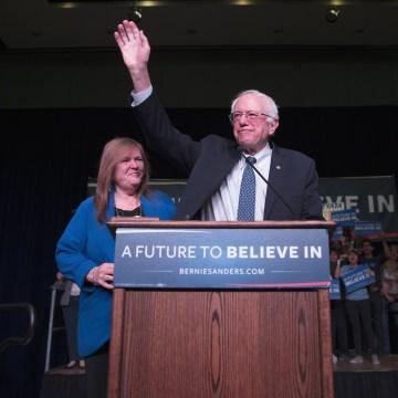 Image: Sen. Bernie Sanders waves after arriving for a canvass kick-off event