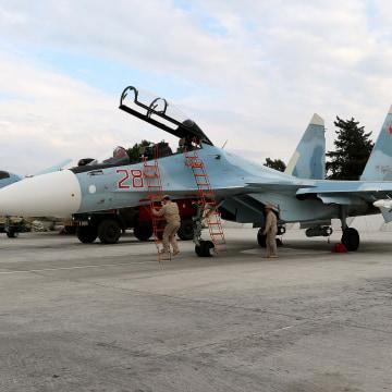 Image: Russian servicemen prepare a Russian Sukhoi Su-30SM fighter jet