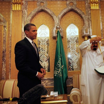 Image: President Barack Obama receives a gift from Saudi King Abdullah at the start of their bilateral meeting