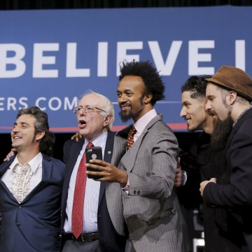 Image: U.S. Democratic presidential candidate Bernie Sanders sings on stage with performers at a campaign rally in Henderson