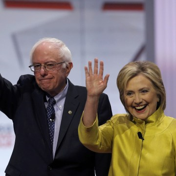 Image: Democratic U.S. presidential candidates Senator Bernie Sanders and former Secretary of State Hillary Clinton arrive on stage before the start of the PBS NewsHour Democratic presidential candidates debate in Milwaukee