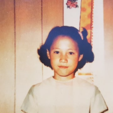 A photograph of Sarah Savidakis at an orphanage in Seoul, South Korea, in 1969, the year before she was adopted by a Connecticut family.