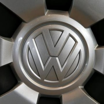 Logo of German carmaker Volkswagen is seen on a wheel at a showroom of AMAG in Duebendorf