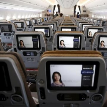A view of the inflight entertainment screen on the back of economy class seats on the first of 67 new Airbus A350-900 planes delivered to Singapore Airlines at Singapore's Changi Airport