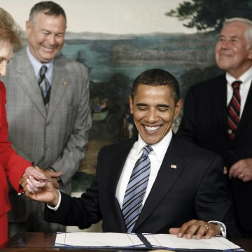Image: President Barack Obama clasps the hand of former first lady Nancy Reagan