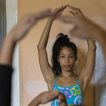 Dance instructor leads a group of dancers at the private art workshop Entreartes, in Havana, Cuba.