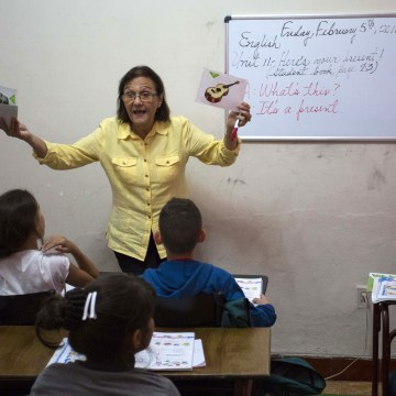 A teacher gives an English lesson at the Cuban School of Foreign Languages in Havana, Cuba.
