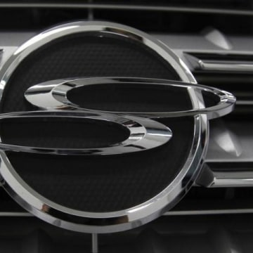 A logo of Ssangyong Motor is seen on the automaker's sport utility vehicle 'Kyron' displayed for customers at the company's branch shop in Seoul