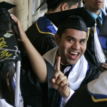 Image: Undocumented UCLA students attend a graduation ceremony at a church near the campus in Los Angeles