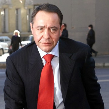 Image: File photo of Russia's Mass Media Minister Mikhail Lesin in central Moscow
