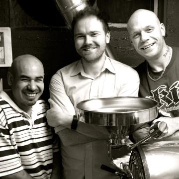 Image: Chris Hoke, middle, with Underground Coffee employees Jesse Garcia, left, and Zach Joy