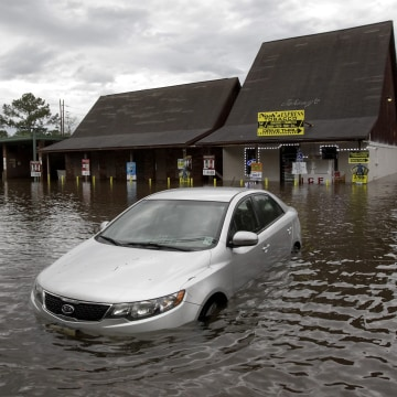 Image: A car sits in flooded water in Hammond, La., Friday, March.