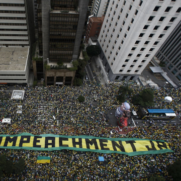 Image: Demonstrators take part in a protest to demand the resignation of Brazilian President Dilma Rousseff