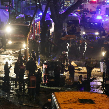 Image:  Emergency workers work at the scene of an explosion