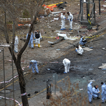 Image: Forensic officials work at the Sunday's explosion site in Ankara