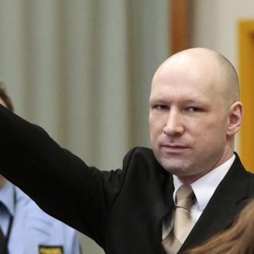 Image: Anders Breivik gestures as he enters a courtroom in Skien, Norway, Tuesday.