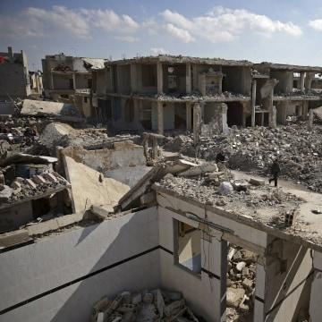 Image: Damaged buildings in Douma, Syria, on Feb. 9, 2016