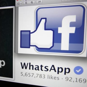 """Illustration photo shows """"likes"""" on WhatsApp's Facebook page displayed on a laptop screen in Paris"""