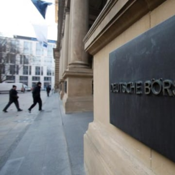 The plaque of the Deutsche Boerse AG is pictured at the entrance of the Frankfurt stock exchange